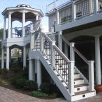Traditional Deck with iron and wood railing