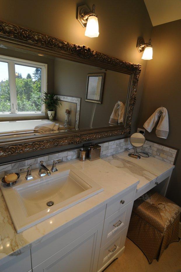 Transitional bathroom in seattle ornate gold framed wall for Classic homes llc