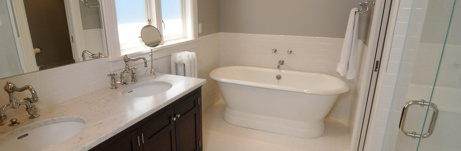Transitional Bathroom with half white subway tiled bathroom wall
