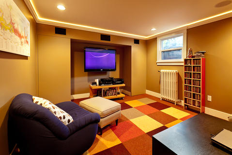 Modern Basement with basement family room with wall mounted tv