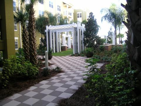Modern Landscape with walkway pads in a checkerboard pattern