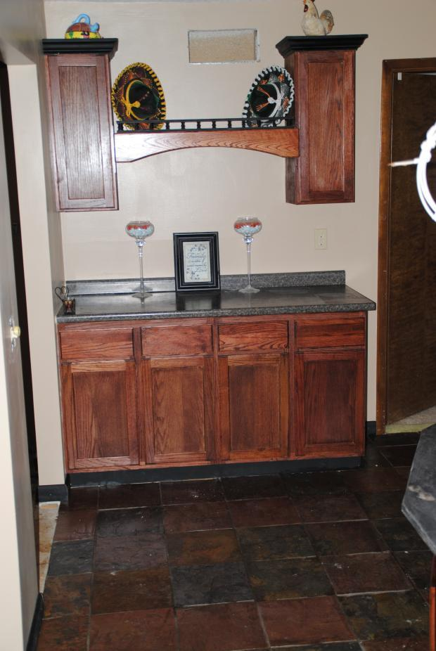 Traditional Bar with dark wood stained cabinets