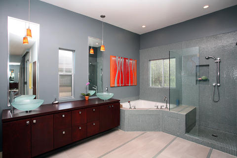 Modern Bathroom with corner drop in tub with tile surround