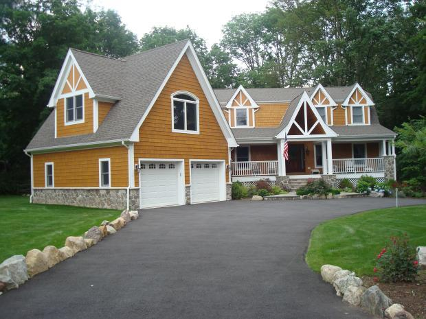 Cape Cod Home Exterior In Belleville Green Wood Siding