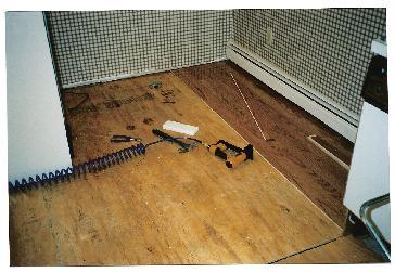How can I stop my dog from scratching my wood floor? - Yahoo