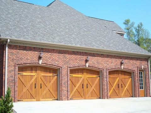 Contemporary Garage with barn style garage doors