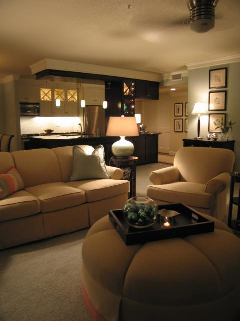 Transitional Family Room with white base table lamp whit white shade