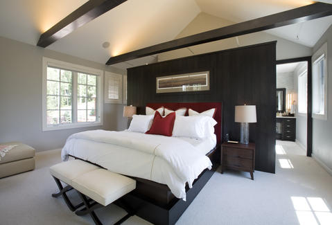 Contemporary Bedroom with stained wood ceiling beams
