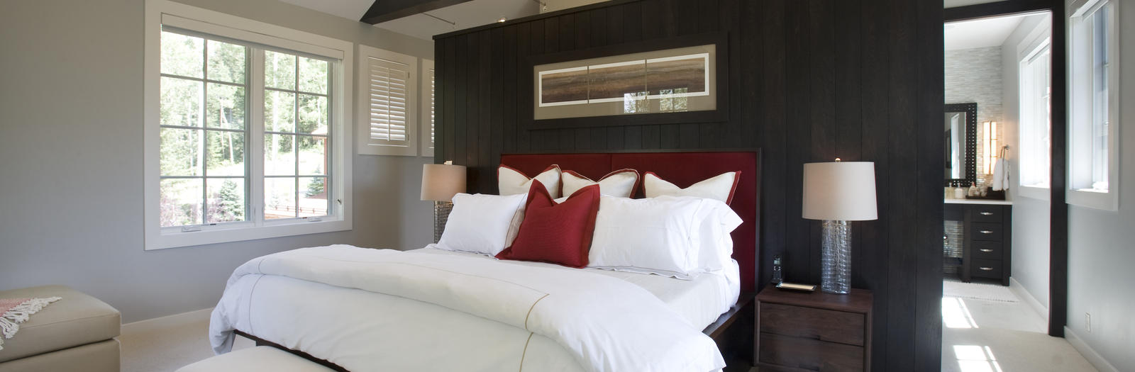 Contemporary Bedroom with stained wood wall paneling