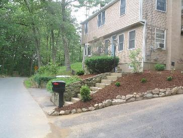 Flower beds with rock border and walkway. Pictures and Photos