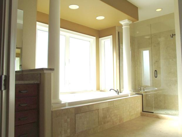 Transitional Master Bathroom with glass shower stall doors