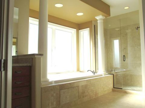 Transitional Master Bathroom with dark wood vanity cabinet
