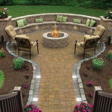 Transitional Patio with dark mulch with bushes