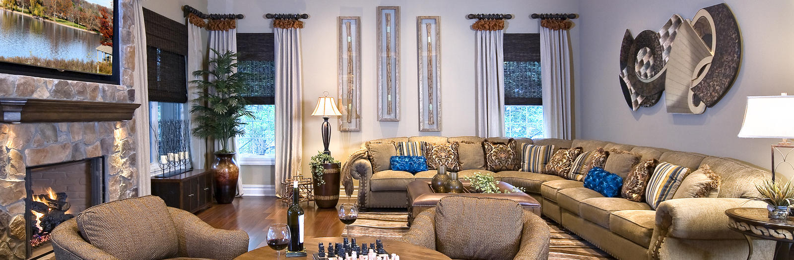Transitional Family Room with custom window treatment