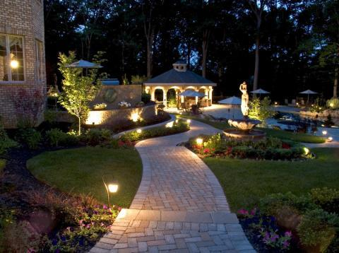 Transitional Landscape with large tiered water fountain feature