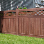 Traditional Landscape with dark stained wood privacy fence